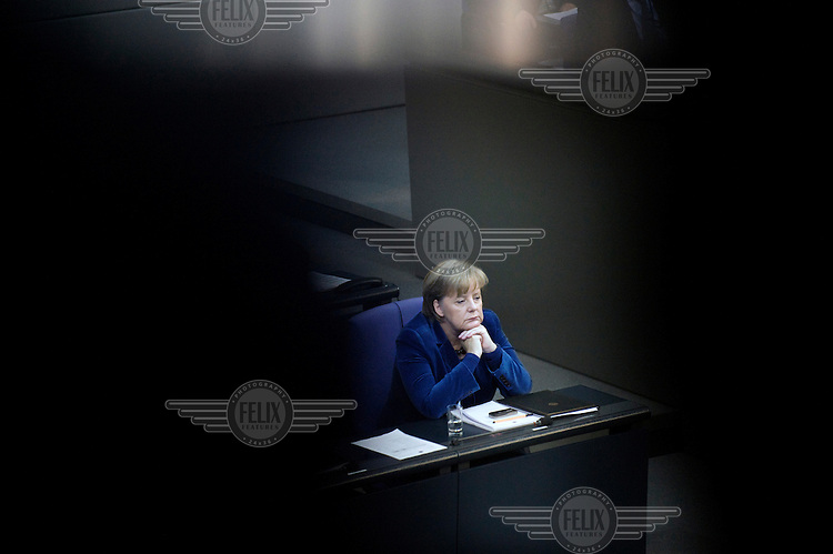 German Chancellor, Angela Merkel, listening to a debate about the Euro crisis inside the Parliament Chamber in the Reichstag.