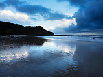 Osgodby Point or Knipe Point and Reflections in Wet Sand at Dusk Cayton Bay Scarborough North Yorkshire England