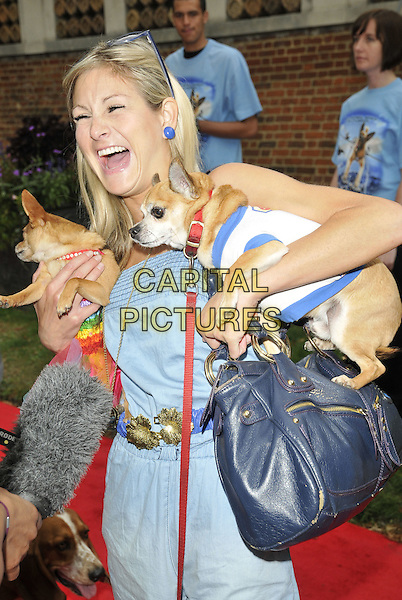 "NIKKI GRAHAM (holding Baby & Thumbelina, her Chihuahuas).""Cats & Dogs: Revenge of Kitty Galore"" UK premiere, Holland Park Open Air Theatre, London, England..August 1st, 2010.half length animal pet blue carrying mouth open funny bag purse playsuit jumpsuit mouth open laughing smiling .CAP/CAN.©Can Nguyen/Capital Pictures."