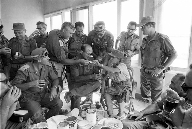 Six Day War: Ariel Sharon (2nd from left, standing) with Moshe Dayan and daughter Yael (both sitting in center) and the Israeli Military High Command, June 1967