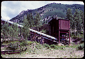 Steel ore bin at Matterhorn.  Trucks dumped ore into the bin and a conveyor moved it up to the Matterhorn Mill for processing.  The RGS track passed very near this bin.<br /> RGS (formerly)  Matterhorn, CO  ca. 1960