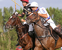 WELLINGTON, FL - APRIL 15:  Agustin Obregon of Palm Beach Illustrated (dark jersey) and Pablo Spinacci of Valiente fight for control of the line in the $100,000 World Cup Final, at the Grand Champions Polo Club, on April 15, 2017 in Wellington, Florida. (Photo by Liz Lamont/Eclipse Sportswire/Getty Images)