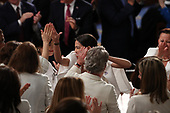 United States Representative Alexandria Ocasio-Cortez (Democrat of New York) with colleagues as United States President Donald J. Trump delivers his second annual State of the Union Address to a joint session of the US Congress in the US Capitol in Washington, DC on Tuesday, February 5, 2019.<br /> Credit: Alex Edelman / CNP