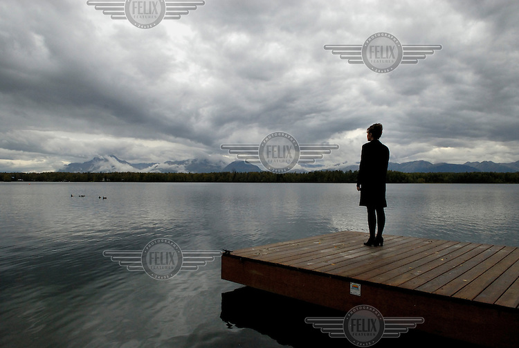 USA. Alaska.  13th September 2007.Governor Palin stands on her jetty looking towards the mountains at her private home in Wasilla..©Andrew Testa/Panos for Newsweek