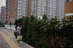 A woman talks on her cell phone at the Olympic Village in Beijing, China on Monday, August 4, 2008. The city of Beijing is gearing up for the opening ceremonies of the Olympic Games.  Kevin German