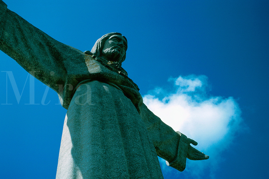 Cristo Rei, in Lisbon suburb of Cacilhas, is 28 meters high and visible from most of Lisbon. It is a smaller version of the statue in Rio de Janeiro and was built in 1959. Jesus Christ Catholic monument sculpture religion. Lisbon (Cacilhas), Portugal.