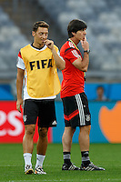 Mesut Ozil with Germany manager Joachim Low