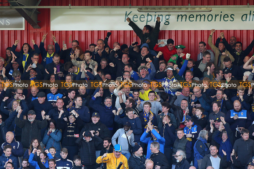 Wimbledon fans celebrate making the play-offs during Stevenage vs AFC Wimbledon, Sky Bet League 2 Football at the Lamex Stadium on 30th April 2016
