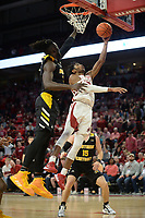 NWA Democrat-Gazette/ANDY SHUPE<br /> Arkansas guard Jimmy Whitt Jr. (right) reaches to score Saturday, Nov. 30, 2019, past Northern Kentucky forward Silas Adheke during the first half of play in Bud Walton Arena. Visit nwadg.com/photos to see more photographs from the game.