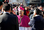 The head of the Roman Catholic Church in the Holy Land, the Latin Patriarch of Jerusalem Fuad Twal greets the crowd outside the Church of the Nativity as Christians gather for Christmas celebrations in the West Bank city of Bethlehem, on December 24, 2015. Pilgrims celebrated Christmas in the town where tradition says Jesus was born Thursday but festivities were subdued against a backdrop of violence in the Holy Land and a growing jihadist threat across the Middle East. Photo by Wisam Hashlamoun