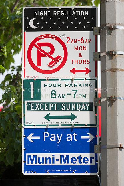 Multiple signs indicating the various parking regulations in-force on a street in New York City