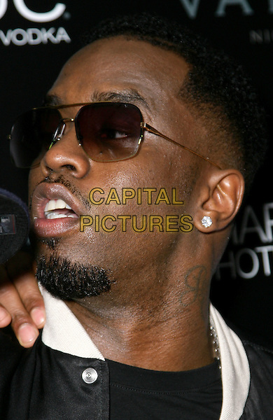 "SEAN ""DIDDY"" COMBS.grand opening of Vanity Nightclub at Hard Rock Hotel and Casino, Las Vegas, Nevada, USA, .2nd January 2010..portrait headshot goatee facial hair earring sunglasses profile black  white .CAP/ADM/MJT.©MJT/Admedia/Capital Pictures"