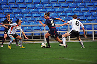 Lauren Cheney splits two German defenders.  The USA captured the 2010 Algarve Cup title by defeating Germany 3-2, at Estadio Algarve on March 3, 2010.