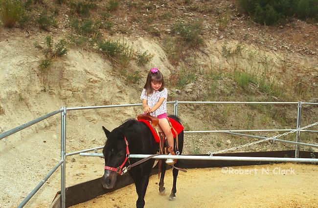 Girl riding pony