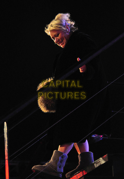 TINA MALONE.Is evicted from the Celebrity Big Brother House, Borehamwood, Herts, England, January 16th 2009..full length black coat uggs ugg boots steps fur.CAP/TTL .©TTL/Capital Pictures