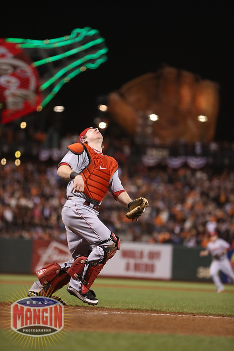 SAN FRANCISCO - OCTOBER 6:  Ryan Hanigan of the Cincinnati Reds chases a pop up during Game 1 of the NLDS against the San Francisco Giants at AT&T Park on October 6, 2012 in San Francisco, California. (Photo by Brad Mangin)