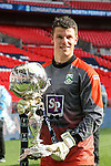 Adam Nicklin of North Ferriby United with the FA Trophy after victory over Wrexham after the FA Carlsberg Trophy Final 2015 at Wembley Stadium on March 29, 2015 in London, England. (Photo by David Horn/EAP)