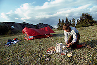 Wilderness Camping along Three Brothers Trail, Camper making Alpine Meal in Cascade Mountains, Manning Provincial Park, BC, British Columbia, Canada (Model Released)
