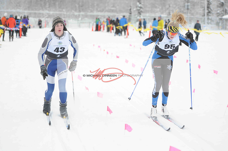 From left, Eagle River's Christian Baldridge (3oth in the boys)  and Chugiak's Adrianna Proffitt (7th in the Girls) finish at the Chugiak Stampede Saturday, January 14, 2017.  Photo for the Star by Michael Dinneen