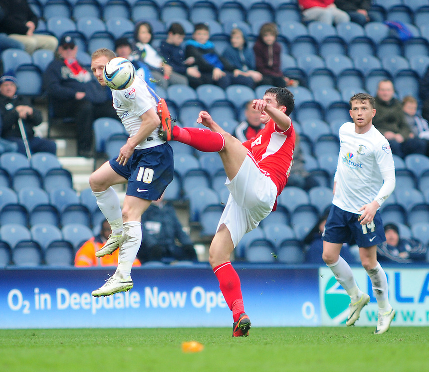 Preston North End's Stuart Beavon vies for possession with Crawley Town's Joe Walsh <br /> <br /> Photo by Chris Vaughan/CameraSport<br /> <br /> Football - The Football League Sky Bet League One - Preston North End v Crawley Town - Saturday 29th March 2014 - Deepdale - Preston<br /> <br /> &copy; CameraSport - 43 Linden Ave. Countesthorpe. Leicester. England. LE8 5PG - Tel: +44 (0) 116 277 4147 - admin@camerasport.com - www.camerasport.com