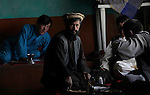 Tajik men enjoy lunch and tea in Sayghan district of Bamiyan Province, Afghanistan.