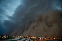 Apr. 26, 2011; Phoenix, AZ, USA; A dust storm converges on downtown Phoenix the home to the 2011 MLB All Star Game at Chase Field. haboob sandstorm dust desert monsoon storm chaser chasing city dusk Arizona