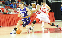 Badger senior Teah Gant lunges for the ball against Wildcats' Allison Mocchi, as Wisconsin loses to Northwestern 68-62 on Sunday, 1/31/10, at the Kohl Center in Madison, Wisconsin