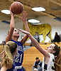 Kristina Dunn #21 of Riverhead, left, draws a shooting foul during a Suffolk County League II girls basketball game against host Northport High School on Friday, Dec. 14, 2018.