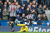 Jacob Murphy of Newcastle United (7) falls under the challenge from Thibaut Courtois of Chelsea during the Premier League match between Chelsea and Newcastle United at Stamford Bridge, London, England on 2 December 2017. Photo by David Horn.