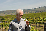 California, San Luis Obispo County: Winemaker Harry Hansen at Edna Valley Vineyards, noted for his Chardonnay. Model released. .Photo caluis101-70751..Photo copyright Lee Foster, www.fostertravel.com, 510-549-2202, lee@fostertravel.com