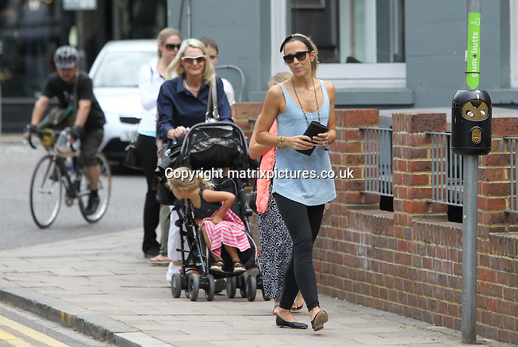 NON EXCLUSIVE PICTURE: MATRIXPICTURES.CO.UK<br /> PLEASE CREDIT ALL USES<br /> <br /> WORLD RIGHTS<br /> <br /> Australian actress, singer and wife of Australian tennis player Lleyton Hewitt, Bec Hewitt is pictured out and about in Wimbledon, London, with her daughters Ava and Mia and Lleyton's mum Cherilyn.<br /> <br /> The group are seen visiting a pharmacy store, before leaving in a taxi. <br /> <br /> JUNE 16th 2015<br /> <br /> REF: MTX 151933