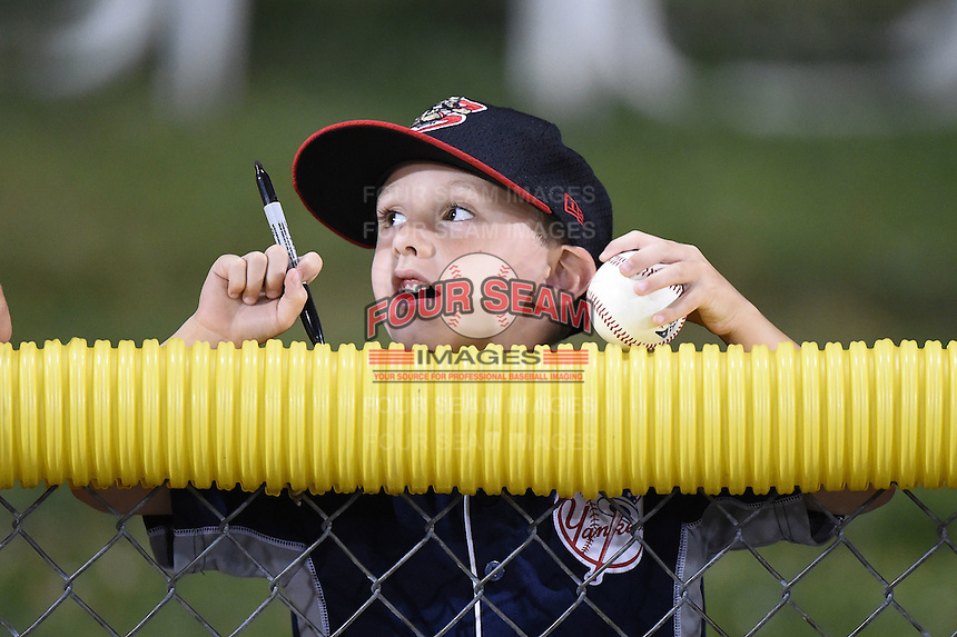 Batavia Muckdogs young fan waits for autographs after a game against the Jamestown Jammers on July 7, 2014 at Dwyer Stadium in Batavia, New York.  Batavia defeated Jamestown 9-2.  (Mike Janes/Four Seam Images)