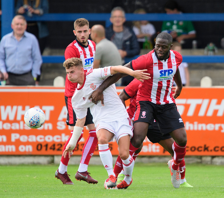 Lincoln City's John Akinde vies for possession with Lincoln United's Charlie West<br /> <br /> Photographer Chris Vaughan/CameraSport<br /> <br /> Football Pre-Season Friendly (Community Festival of Lincolnshire) - Lincoln City v Lincoln United - Saturday 6th July 2019 - The Martin & Co Arena - Gainsborough<br /> <br /> World Copyright © 2018 CameraSport. All rights reserved. 43 Linden Ave. Countesthorpe. Leicester. England. LE8 5PG - Tel: +44 (0) 116 277 4147 - admin@camerasport.com - www.camerasport.com