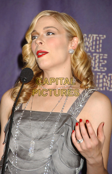 LeANN RIMES.2008 CMT Music Awards held at Curb Center, Nashville, Tennessee, USA..April 14th, 2008.half length grey gray ruffle layered layers microphone hand nail varnish polish silver red lipstick necklaces .CAP/ADM/LF.©Laura Farr/AdMedia/Capital Pictures.