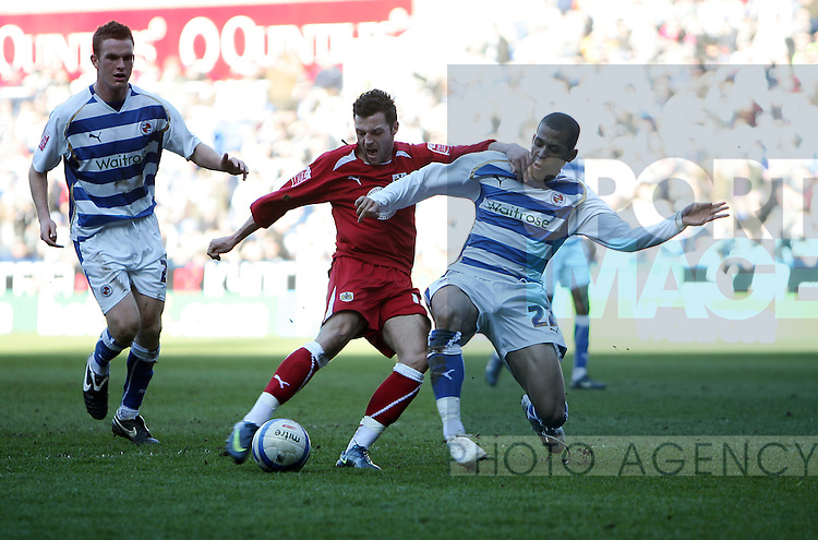 Ivan Sproule of Bristol City has a shot blocked by Liam Rosenior of Reading
