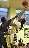 Jaiyetoro Gordon-Younge #35 of Elmont, right, and Marquis Mitchell #4 of of Central Islip battle for a rebound during a non-league varsity boys basketball game in the Richard Brown Nassau-Suffolk Challenge at Uniondale High School on Saturday, Jan. 13, 2018. Central Islip won by a score of 63-56.