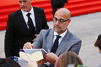 Stanley Tucci signs autographs on the red carpet to present the movie 'Spotlight' during the 72nd Venice Film Festival at the Palazzo Del Cinema, in Venice, September 3, 2015. <br /> UPDATE IMAGES PRESS/Stephen Richie