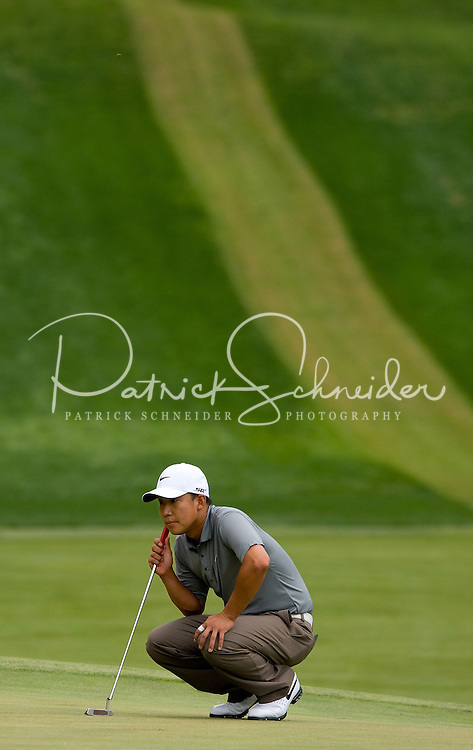 PGA golfer Anthony Kim lines up a putt during the 2008 Wachovia Championships at Quail Hollow Country Club in Charlotte, NC.