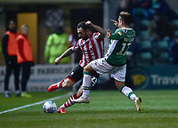 Lincoln City's Neal Eardley vies for possession with Yeovil Town's Alex Pattison<br /> <br /> Photographer Andrew Vaughan/CameraSport<br /> <br /> The EFL Sky Bet League Two - Lincoln City v Yeovil Town - Friday 8th March 2019 - Sincil Bank - Lincoln<br /> <br /> World Copyright © 2019 CameraSport. All rights reserved. 43 Linden Ave. Countesthorpe. Leicester. England. LE8 5PG - Tel: +44 (0) 116 277 4147 - admin@camerasport.com - www.camerasport.com