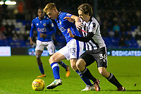 Oldham Athletic's Eoin Doyle (L) shields the ball from Rochdale's Matt Gillam during the Sky Bet League 1 match between Oldham Athletic and Rochdale at Boundary Park, Oldham, England on 18 November 2017. Photo by Juel Miah/PRiME Media Images