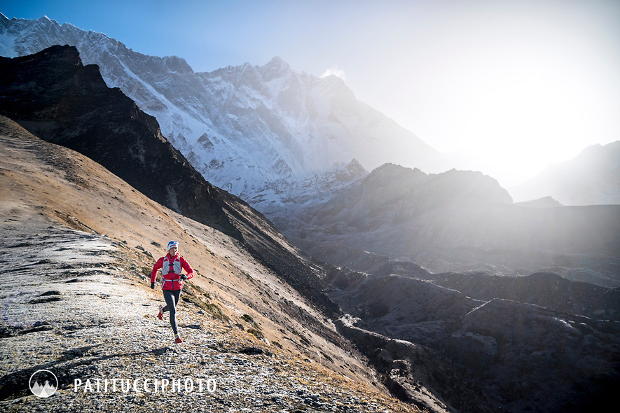Trail running on Chukhung Ri, a 5546 meter highpoint above Chukhung, in the Khumbu Region of Nepal.