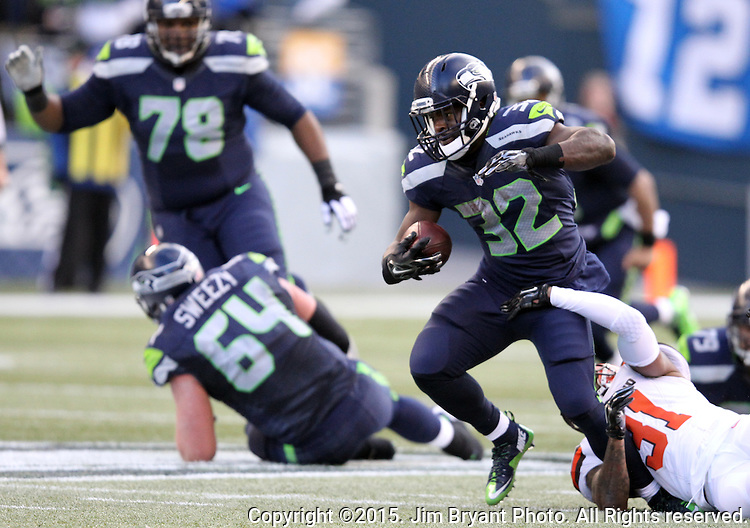 Seattle Seahawks running back Christian Michael breaks a tackle by Cleveland Browns defensive back Donte Whitner (31)  at CenturyLink Field in Seattle, Washington on December 20, 2015. The Seahawks clinched their fourth straight playoff berth in four seasons by beating the Browns 30-13.  ©2015. Jim Bryant Photo. All Rights Reserved.