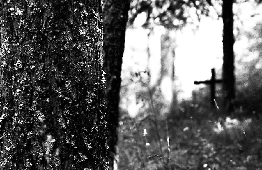 A cross in the middle of the woods is a common sign near Vajont. On October 9th 1963 a giant landslide collapses into the artificial lake created by the Vajont Dam in northern Italy, provoking a 250 meters high wave that completely destroys the settlements near the lake and the town of Longarone far down in the valley below the dam. 1910 people lost their lives in a tragedy that easily could have been avoided if it was not for the economical and political interests of powerful men dreaming of the tallest dam in the world. A tragedy that is still alive today in Erto, Casso and Longarone, where the survivers of that disastrous day almost 50 years ago are still fighting for their justice.