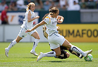 FC Gold Pride's Formiga is tackled by LA Sol Midfielder Camille Abile. The LA Sol defeated FC Gold Pride of the Bay Area 1-0 at Home Depot Center stadium in Carson, California on Sunday April 19, 2009.  ..  .