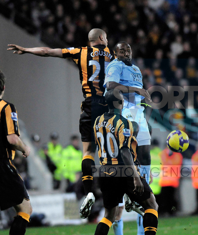 Hull's Daniel Cousin and Manchester City's Darius Vassell.
