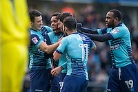 Joe Jacobson of Wycombe Wanderers celebrates his goal with teammates during the Sky Bet League 2 match between Wycombe Wanderers and Yeovil Town at Adams Park, High Wycombe, England on 14 January 2017. Photo by Andy Rowland / PRiME Media Images.