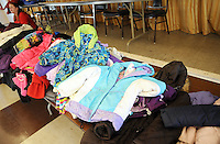 CROYDON PA - DECEMBER 27: Coats await new owners at a Christmas luncheon and coat give away for people in need December 27, 2014 at Father Crehan Hall in Croydon, Pennsylvania. (Photo by William Thomas Cain/Cain Images)