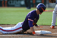 Third Baseman Richie Shaffer #8 slides head first into third during a  game against the Miami Hurricanes at Doug Kingsmore Stadium on March 31, 2012 in Clemson, South Carolina. The Tigers won the game 3-1. (Tony Farlow/Four Seam Images)..