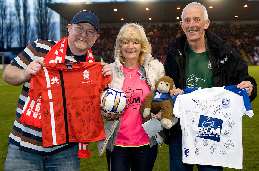 Fans from Lincoln City and Tranmere Rovers with memorabilia for the Bradley Lowrey appeal<br /> <br /> Photographer Andrew Vaughan/CameraSport<br /> <br /> Vanarama National League - Lincoln City v Tranmere Rovers - Saturday 17th December 2016 - Sincil Bank - Lincoln<br /> <br /> World Copyright &copy; 2016 CameraSport. All rights reserved. 43 Linden Ave. Countesthorpe. Leicester. England. LE8 5PG - Tel: +44 (0) 116 277 4147 - admin@camerasport.com - www.camerasport.com