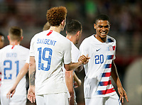 GEORGETOWN, GRAND CAYMAN, CAYMAN ISLANDS - NOVEMBER 19: Josh Sargent #19 of the United States celebrates his goal with team mate Reggie Cannon #20 during a game between Cuba and USMNT at Truman Bodden Sports Complex on November 19, 2019 in Georgetown, Grand Cayman.